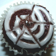 Chocolate cupcake with white spider web icing