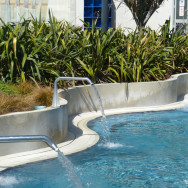 Heated play pool with water spouts