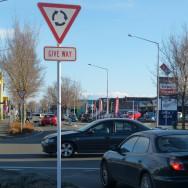 Give way road sign at roundabout